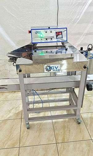 Máquina seladora com esteira
